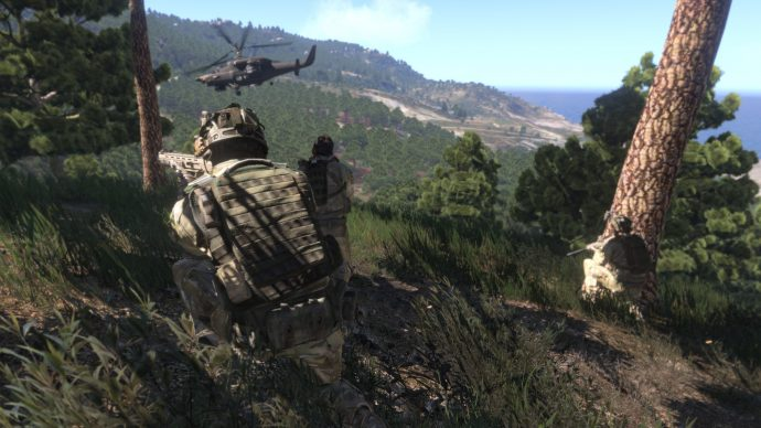 A screenshot of players crouched in tall grass in Arma 3.