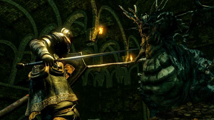 A screenshot of a night facing a huge spider creature in Dark Souls: Remastered.