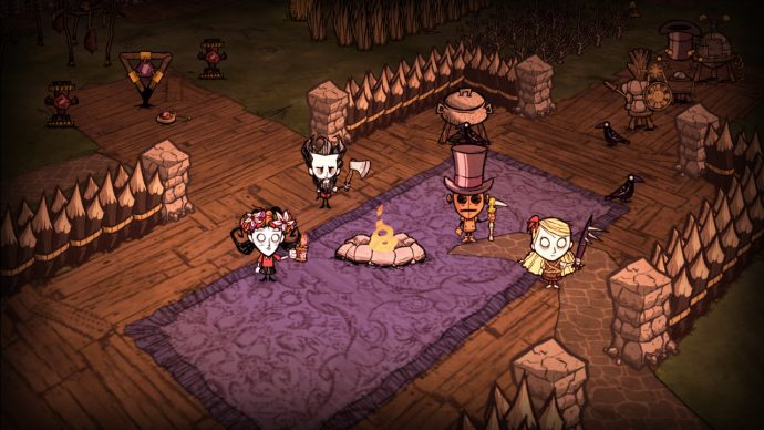 Player's round a campfire together in Don't Starve Together's co-op.