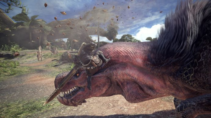 A screenshot of a character tackling one of the huge dinosaur creates in Monster Hunter: World.