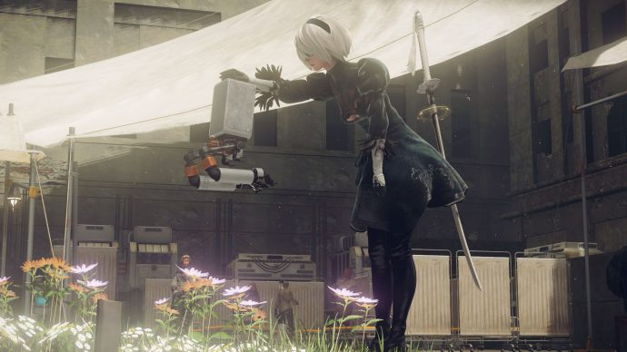 A screenshot of the protagonist 2B petting a small robot in Nier: Automata.