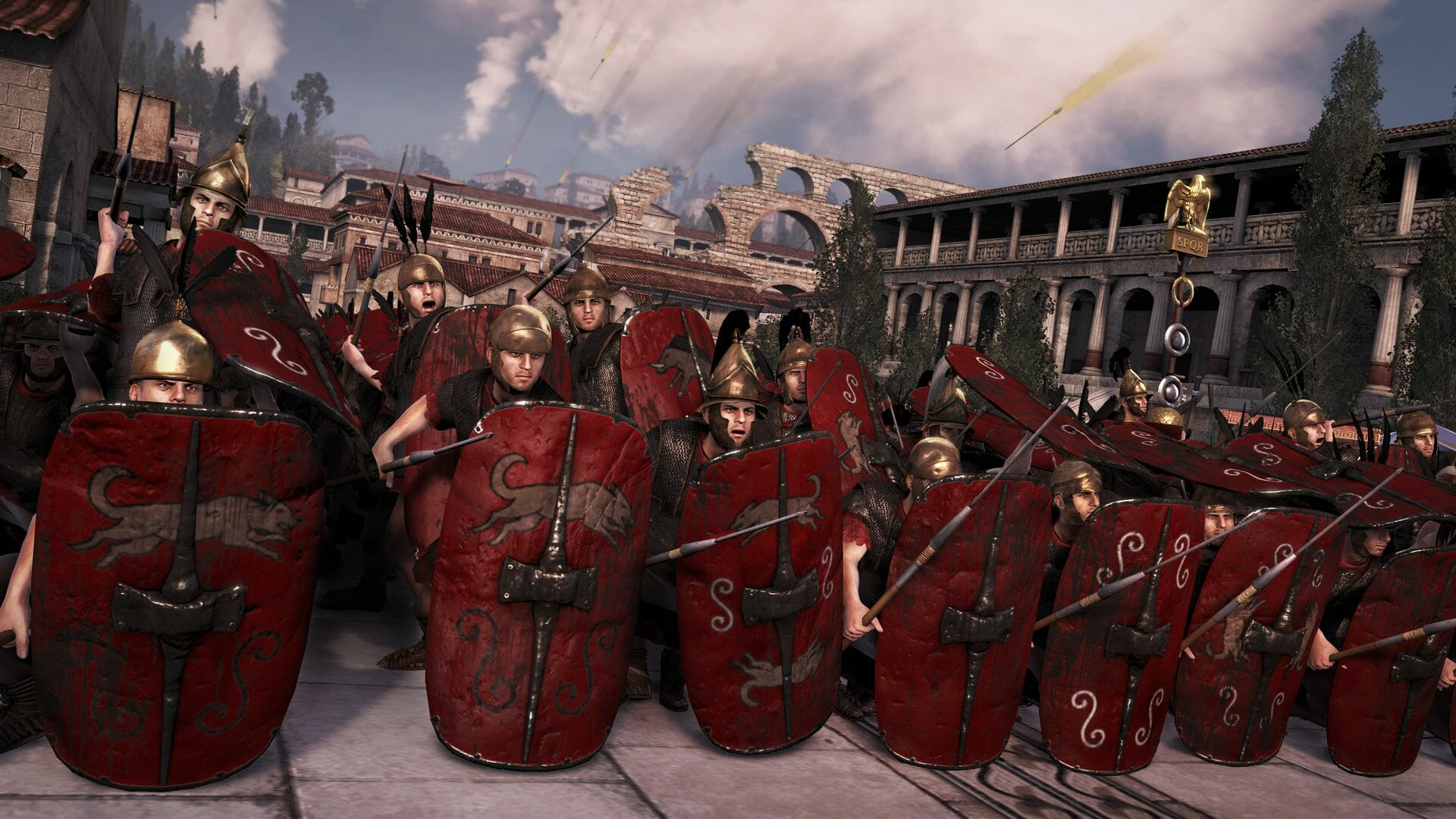 A screenshot from Total War Rome 2 showing a group of legionnaires forming a shield wall during battle