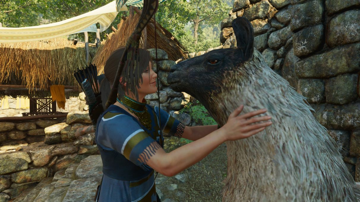 A screenshot of Lara Croft embracing a llama in Shadow Of The Tomb Raider