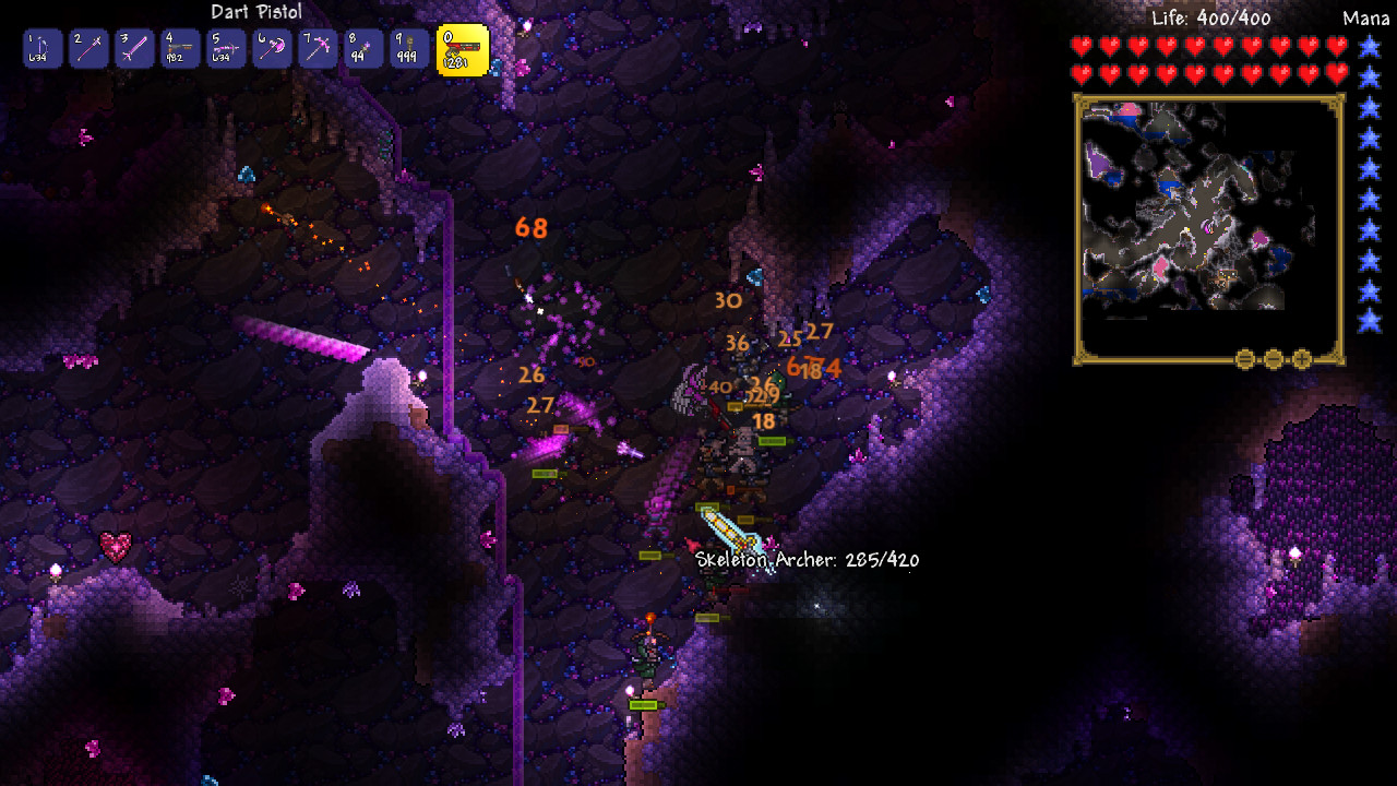 A screenshot of a cave full of monsters in Terraria.