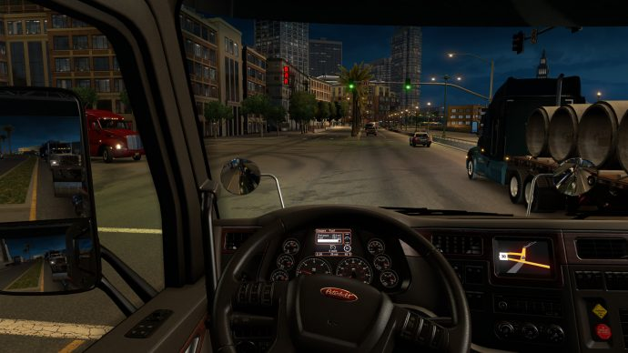A screenshot of a night scene from inside your truck in American Truck Simulator.
