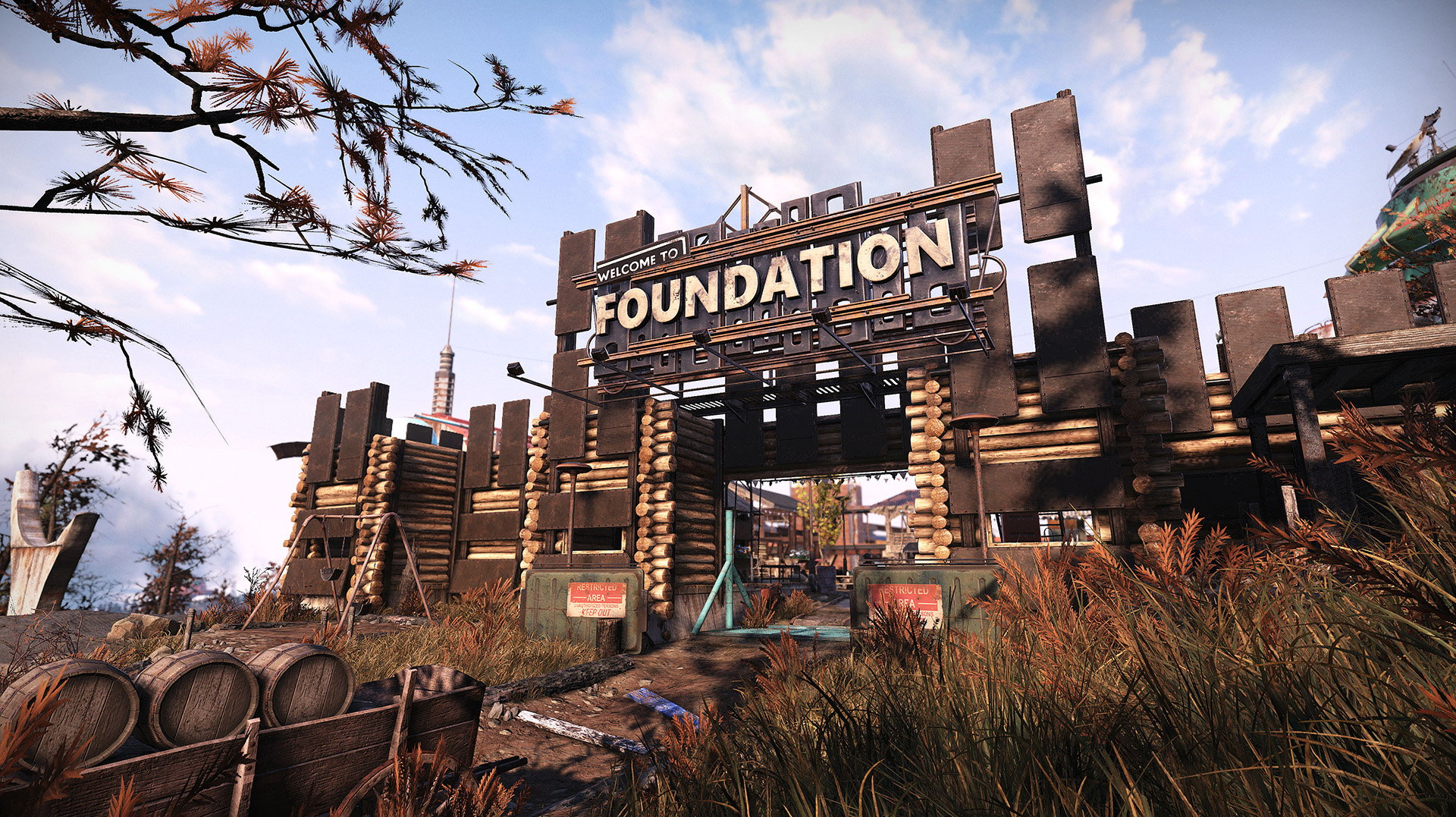 A screenshot of the front gate of Foundation, sort of resembling an old timey fort made from scrap