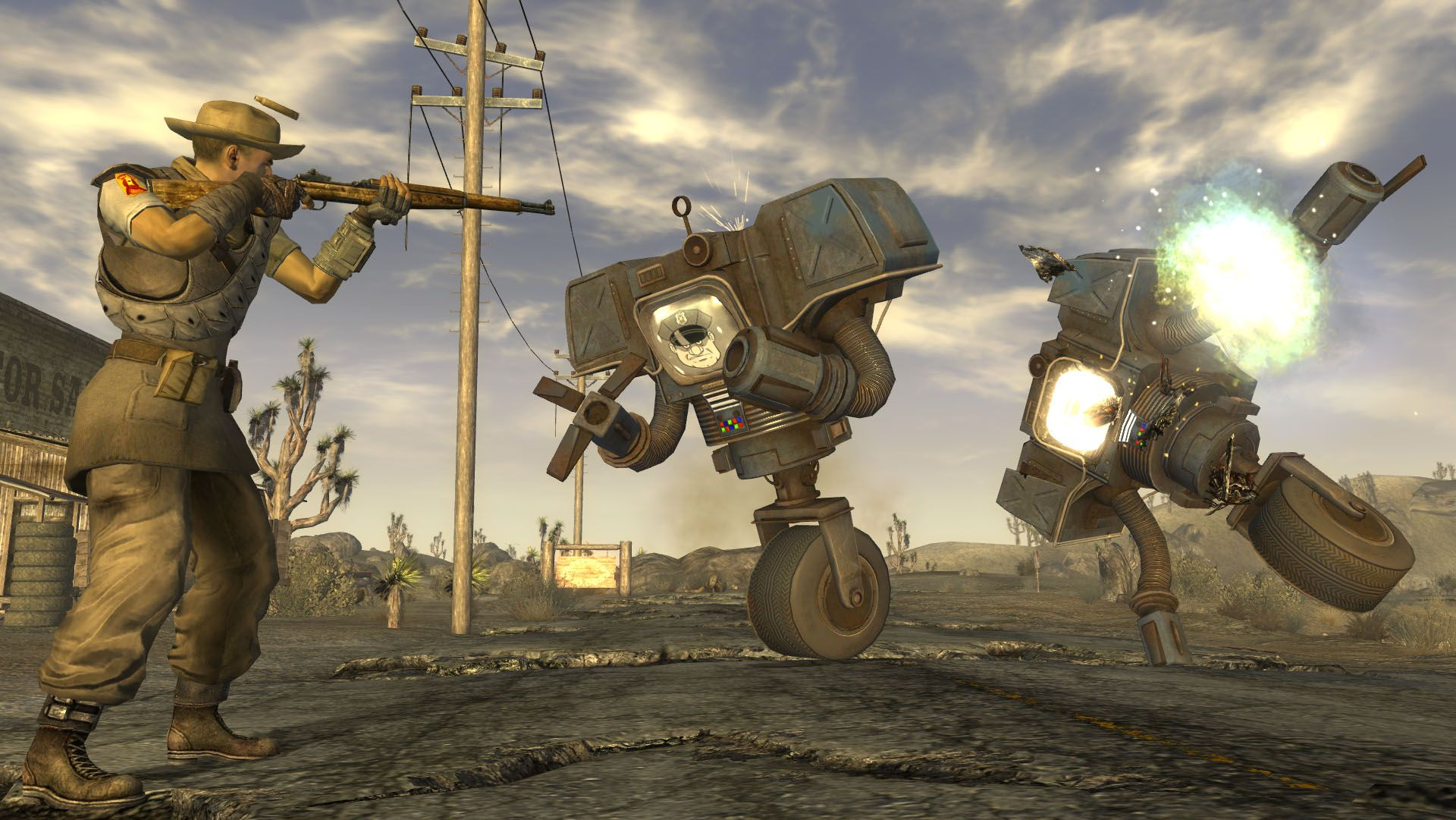 The player character in Fallout: New Vegas in a gunfight with two wasteland robots