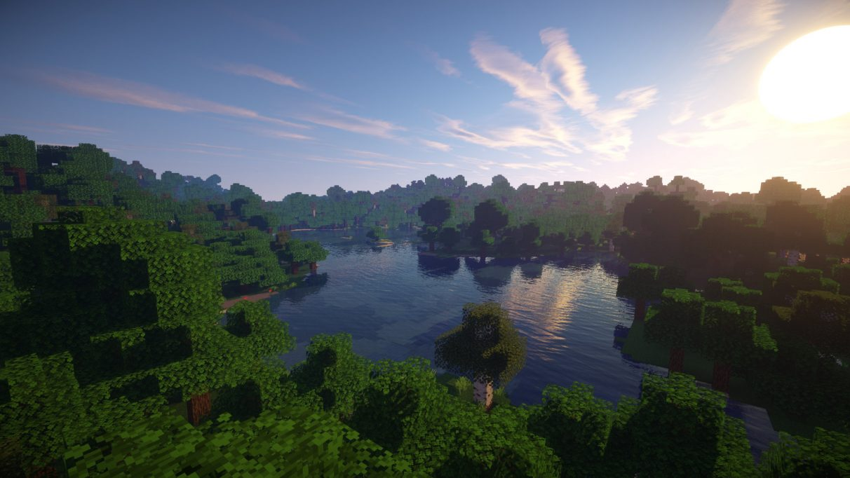 A tranquil forest lake at dawn is made even more beautiful with Sonic Ether's Unbelievable Shaders for 1.16.2.