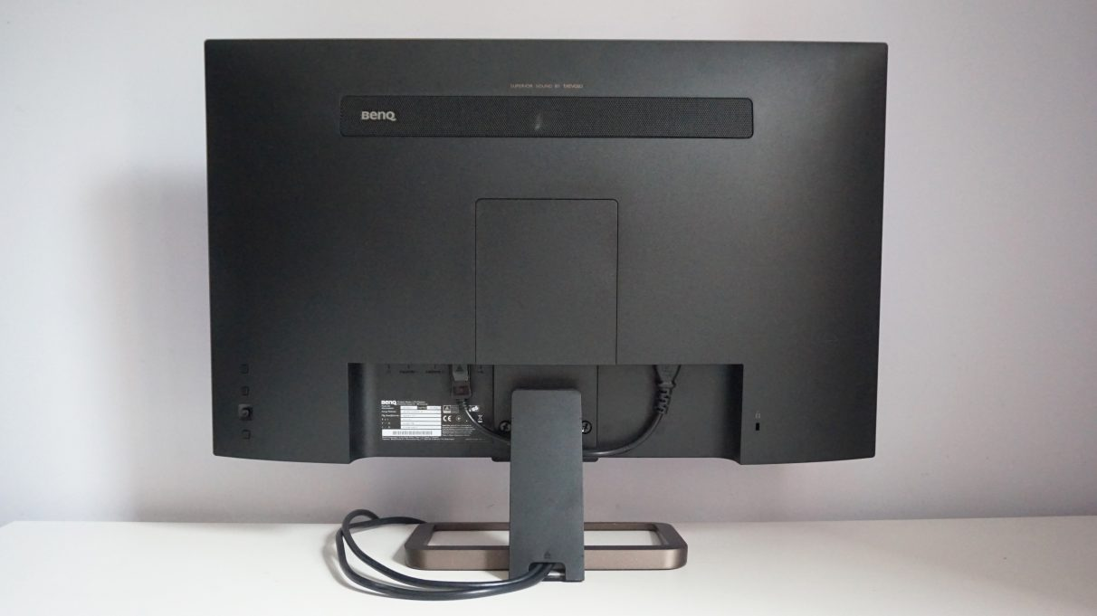 A rear image of the BenQ EX2780Q monitor showing its fixed stand and rear control panel.
