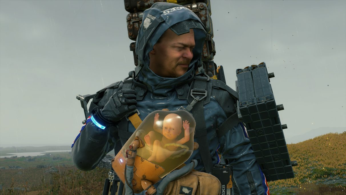 A screenshot of Sam Bridges pulling a strained face with a smiling BB in Death Stranding.