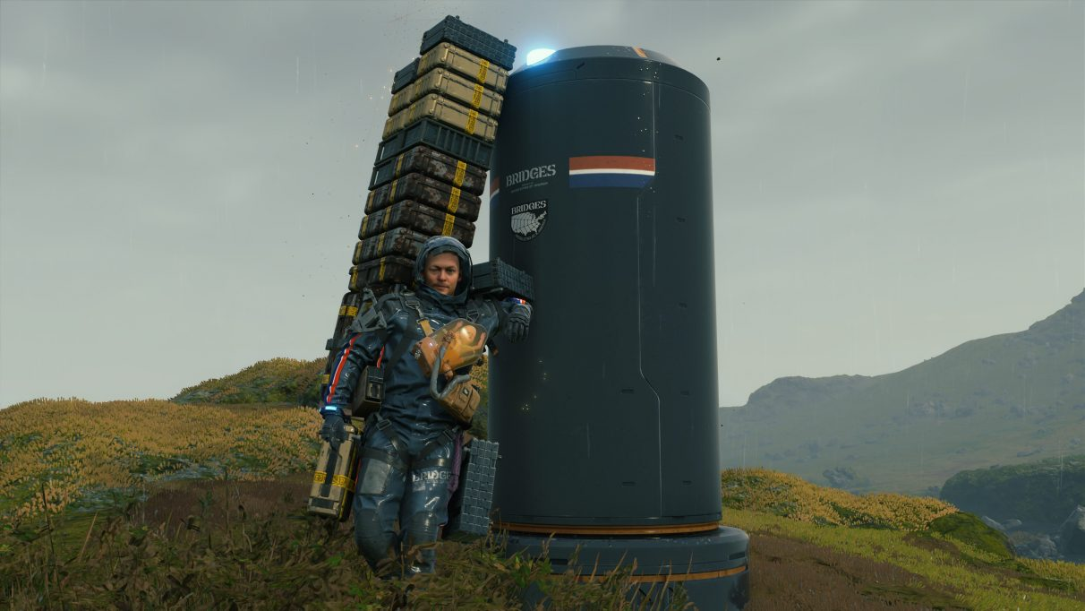 A screenshot of Sam Bridges leaning against a postbox in Death Stranding.