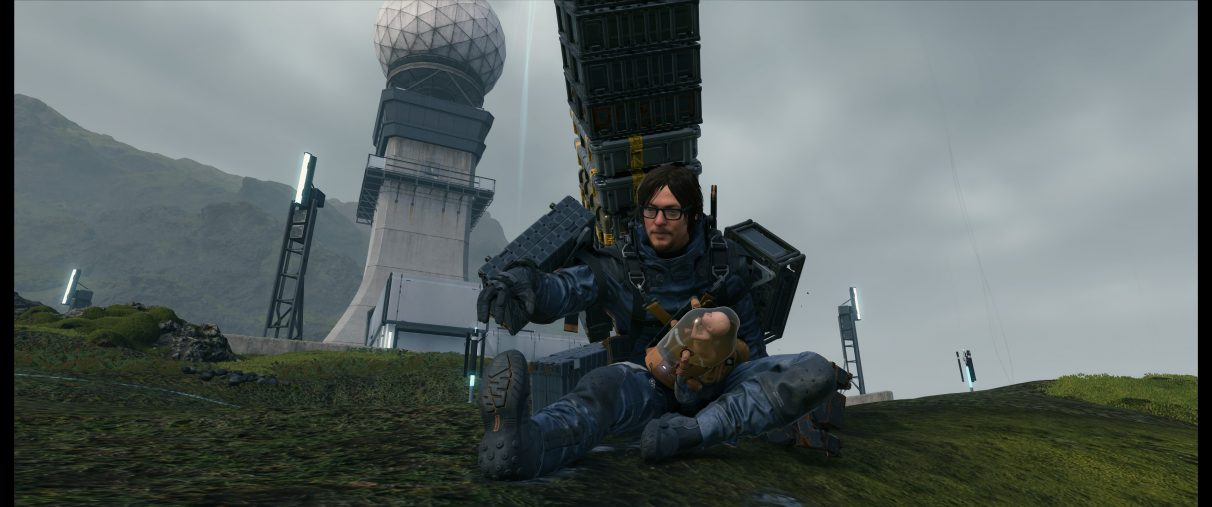 An ultrawide screenshot of Sam Bridges stretching on the ground in Death Stranding.