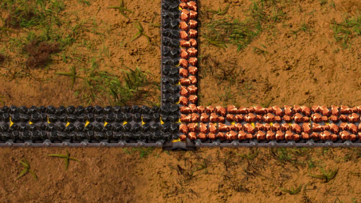 An example of how you can transport multiple item types on a single belt in Factorio.