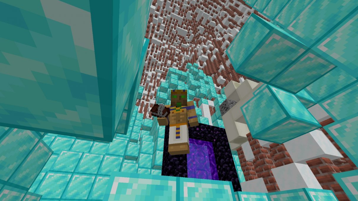 A blocky pharaoh stands in a weird cavern made of diamond blocks, bricks and snow.