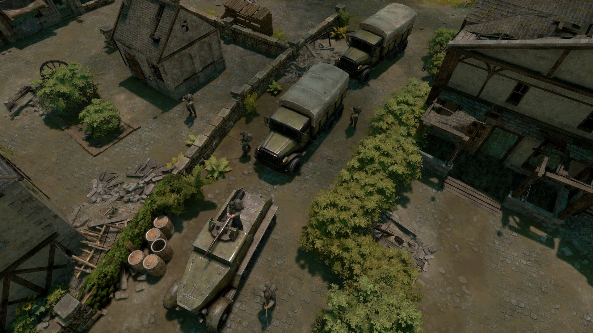 A screenshot showing a birds eye view of trucks advancing through a village in Foxhole
