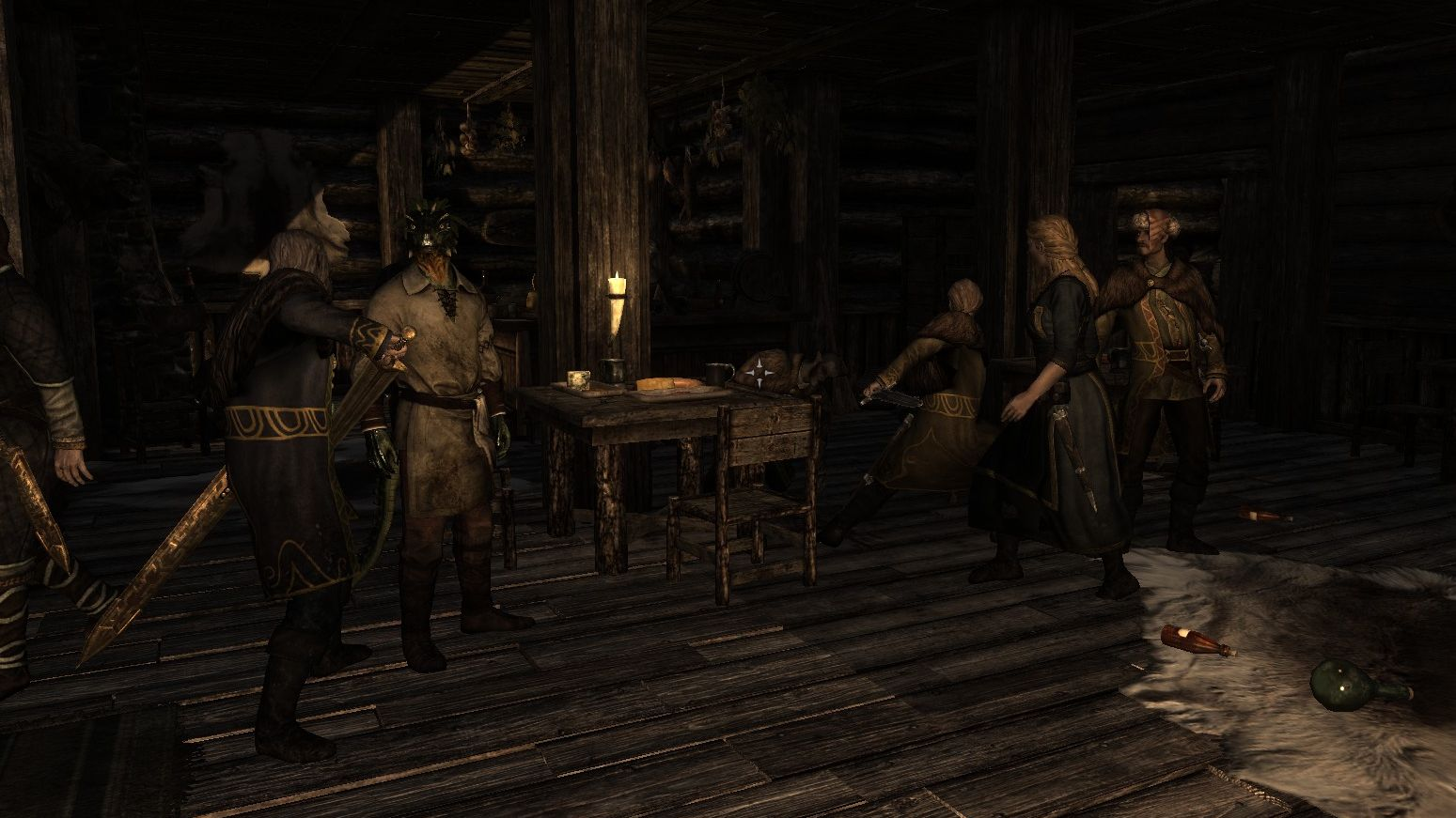 The interior of a pub in Riften from Skyrim. The walls, ceiling, floor and furniture are all made from the same dark wood. It is lit by one candle, and there are a lot of empty bottles on the floor.