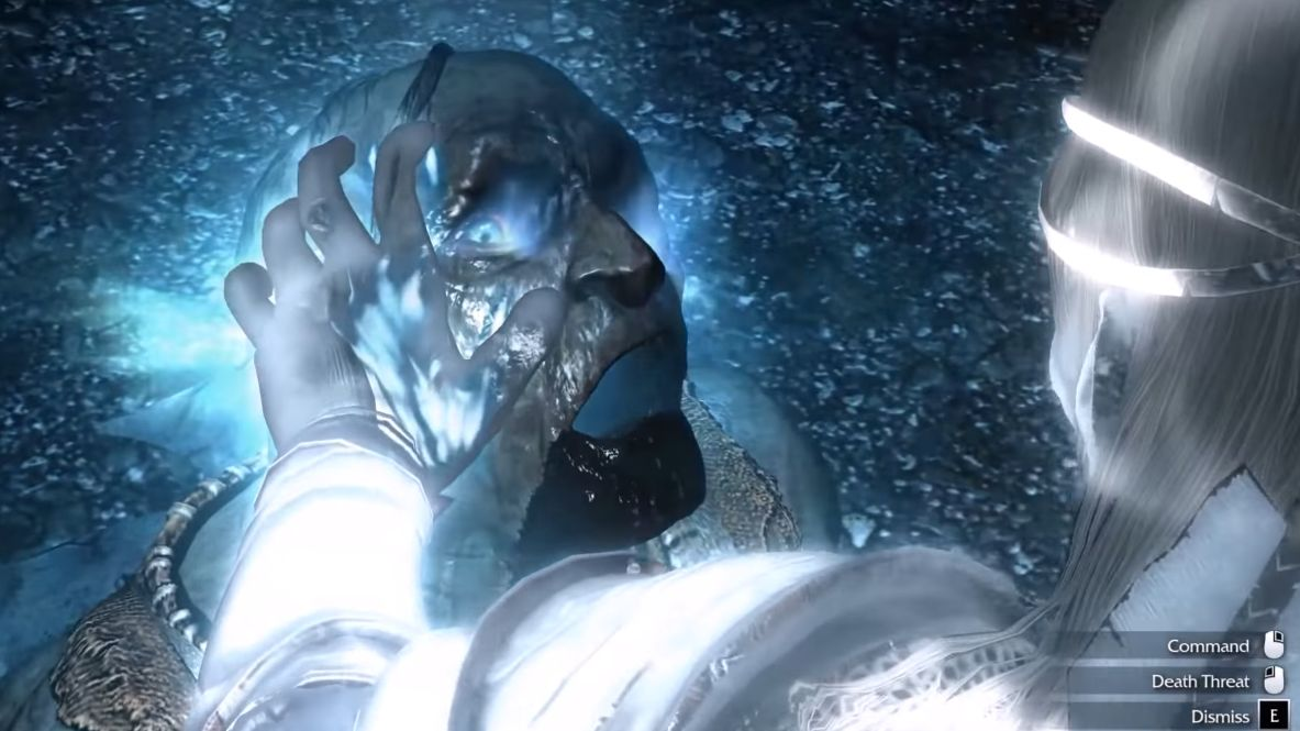 A screenshot from The Shadow Of Mordor showing an orc being 'branded'. The camera is over the shoulder of the player character, who has pressed his hand to the orc's face, and it burns with white magic. The orc looks, it is fair to say, distressed.