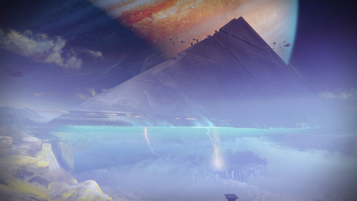 A Destiny 2 screenshot showing a vast Darkness pyramid hanging over the Jovian moon of Io.