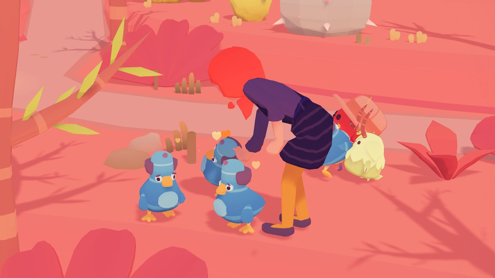 A screenshot showing the player petting a wild ooblet that looks like a balding pigeon