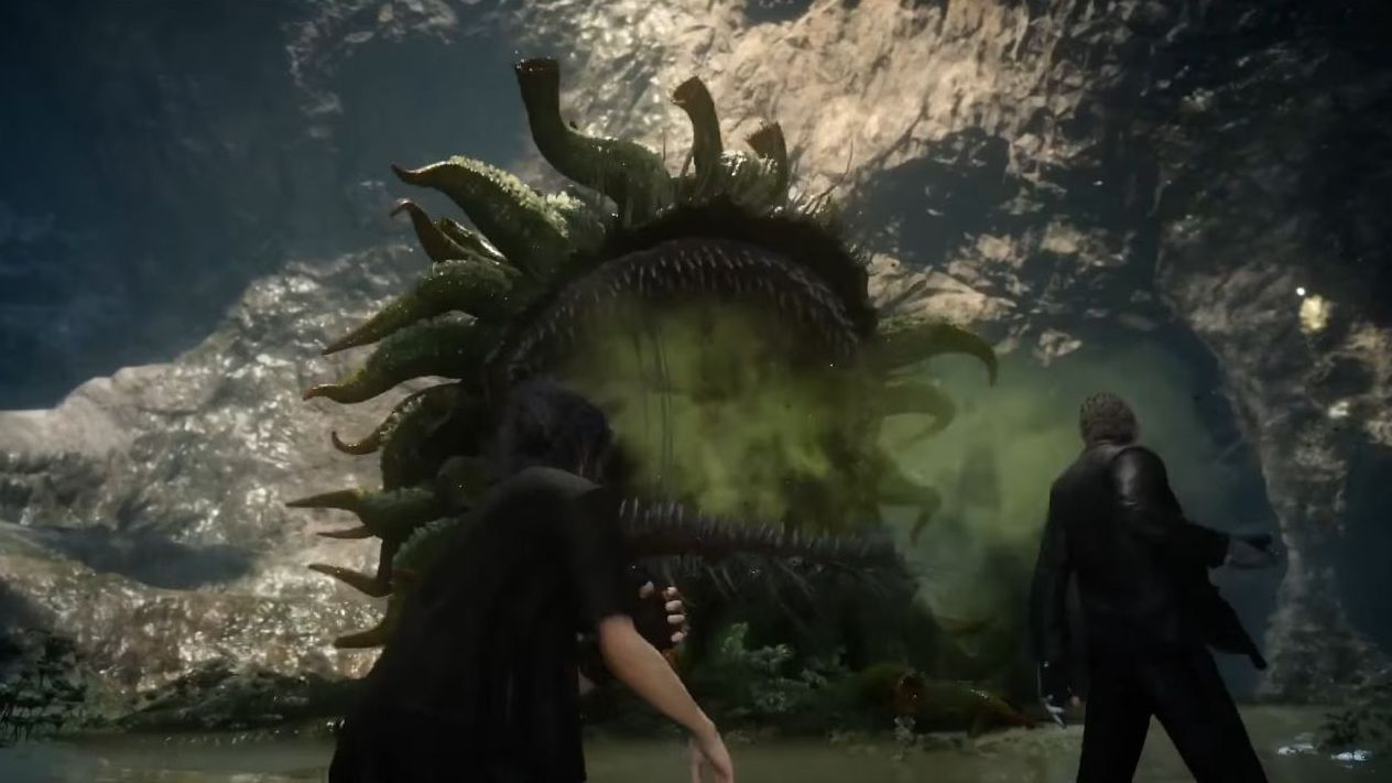 A screenshot from Final Fantasy XV showing several of the characters ranged around a cave looking at a Malboro, a large ball of thick tentacles with a wide mouth. Its mouth is open showing rows of sharp, thin teeth, and it is breathing out a fog of stinky green breath.