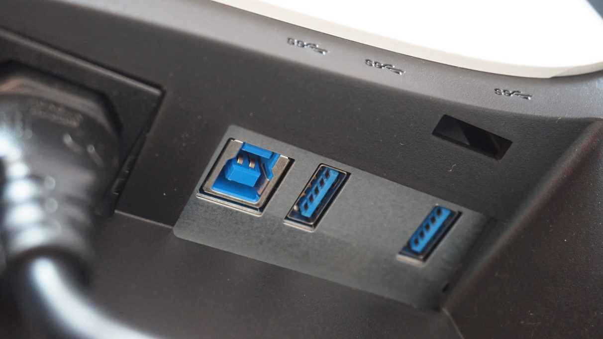 A photo showing the other two USB 3.0 ports on the Alienware AW2521HFl, which are located on the back of the monitor next to the power plug.