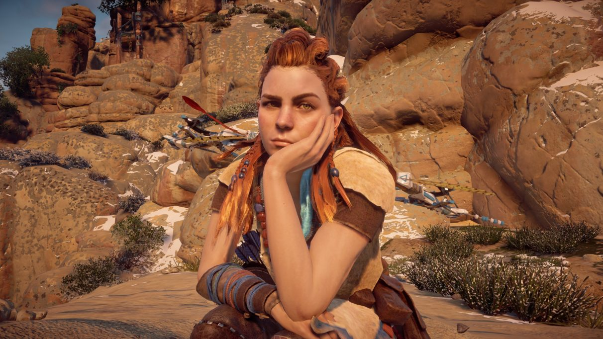 A screenshot of Aloy with her head in her hand from Horizon Zero Dawn.