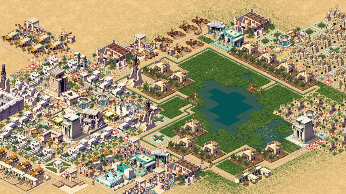 A promotional screenshot of Pharaoh: A New Era showing a city in top down isometric view. There is a more affluent neighbourhood of nice houses on the left, some less nice houses on the right, and granaries and other municipal buildings around a lake or pond in the middle.