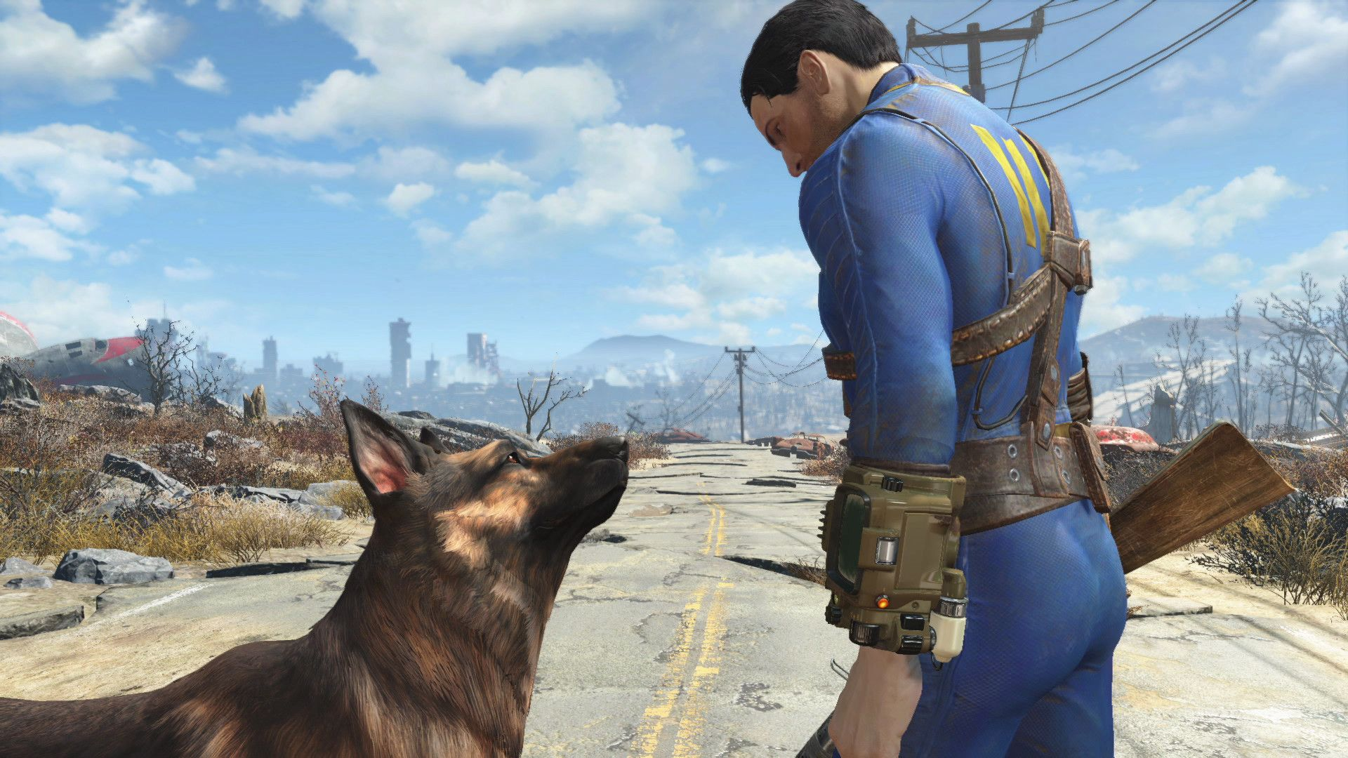 A screenshot from Fallout 4 showing the vault dweller, in their blue and yellow jumpsuit, and Dogmeat, a scruffy Alsatian. They are standing in a blasted, iradiated wilderness, but looking at each other fondly.