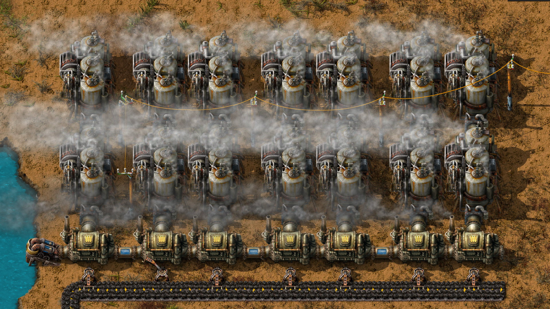 A line of engines belching out smoke in a Factorio screenshot
