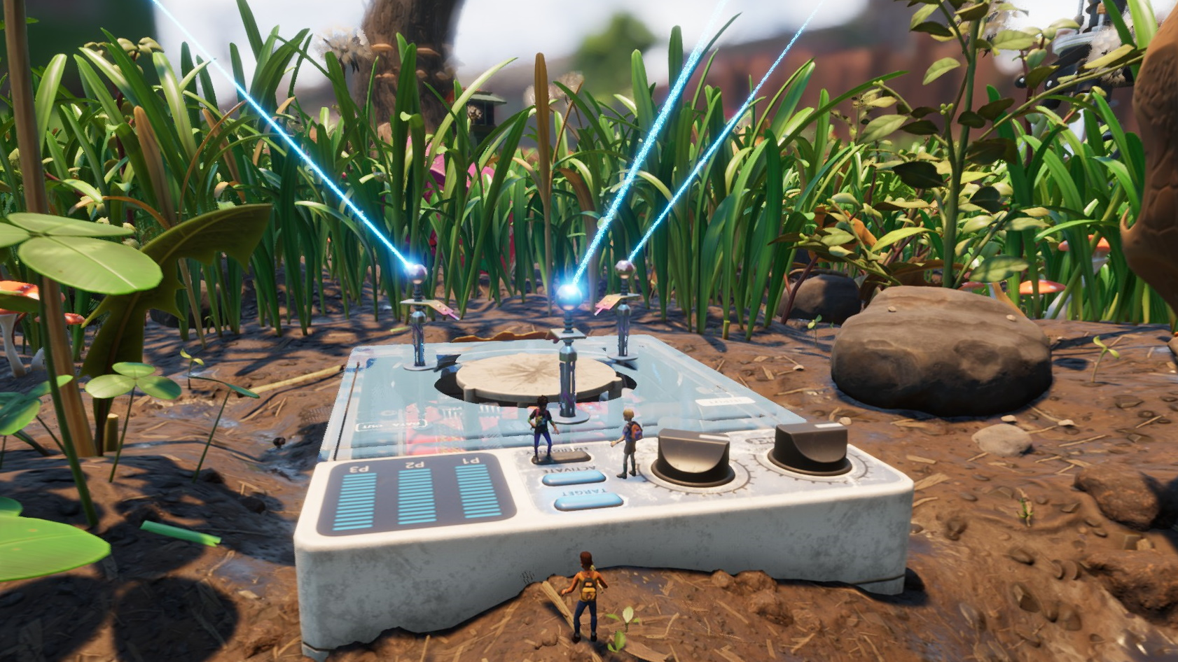 A zoomed out view of several tiny players standing on and around a small (but huge to them) device surrounded by soil and huge grass stalks. Lasers beam out of antennae on the device.