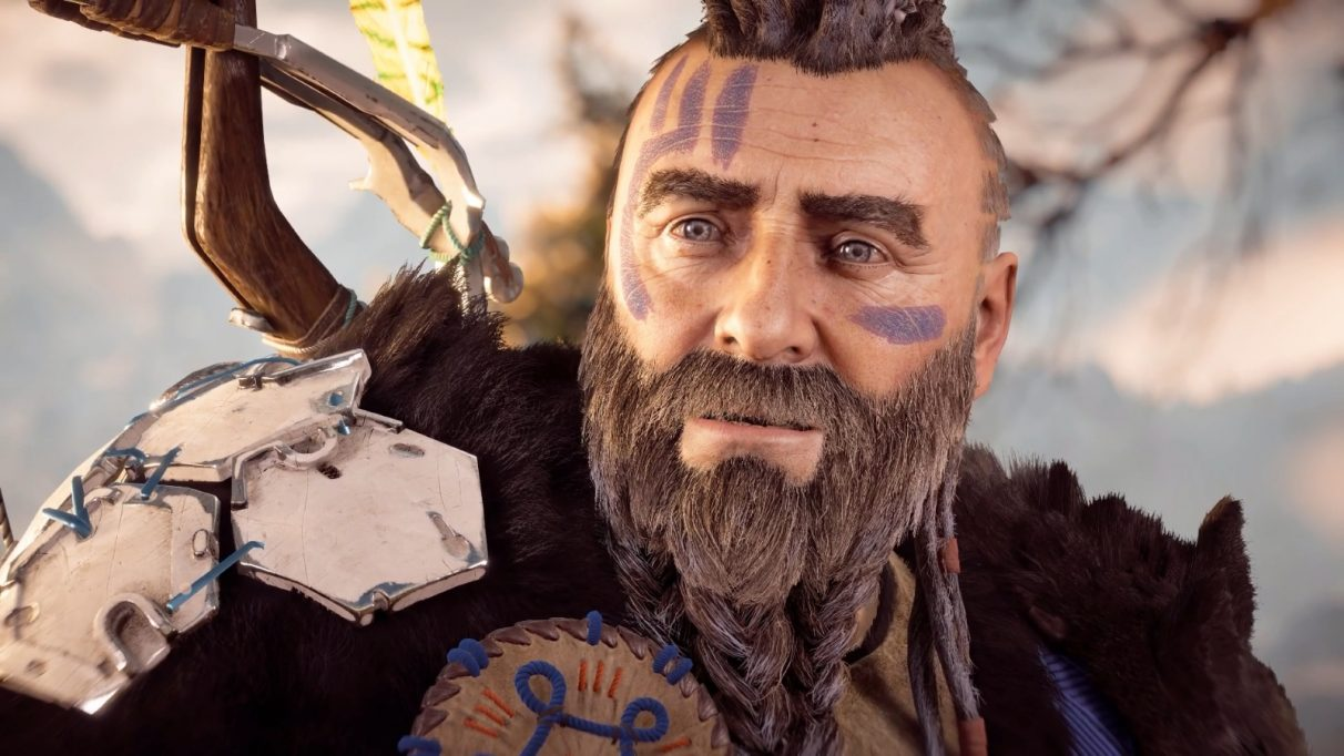 Rost, the main dad in Horizon Zero Dawn, looks to the left of the camera with an expression of awe and surprise.
