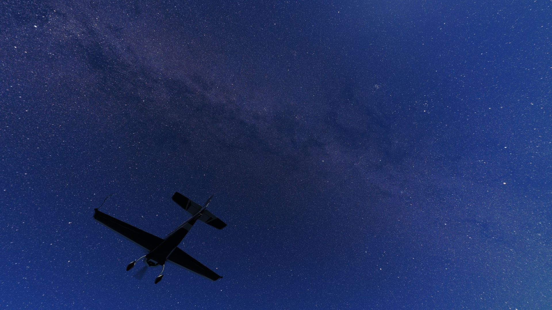 In Microsoft Flight Simulator, a plane flies below the milky way