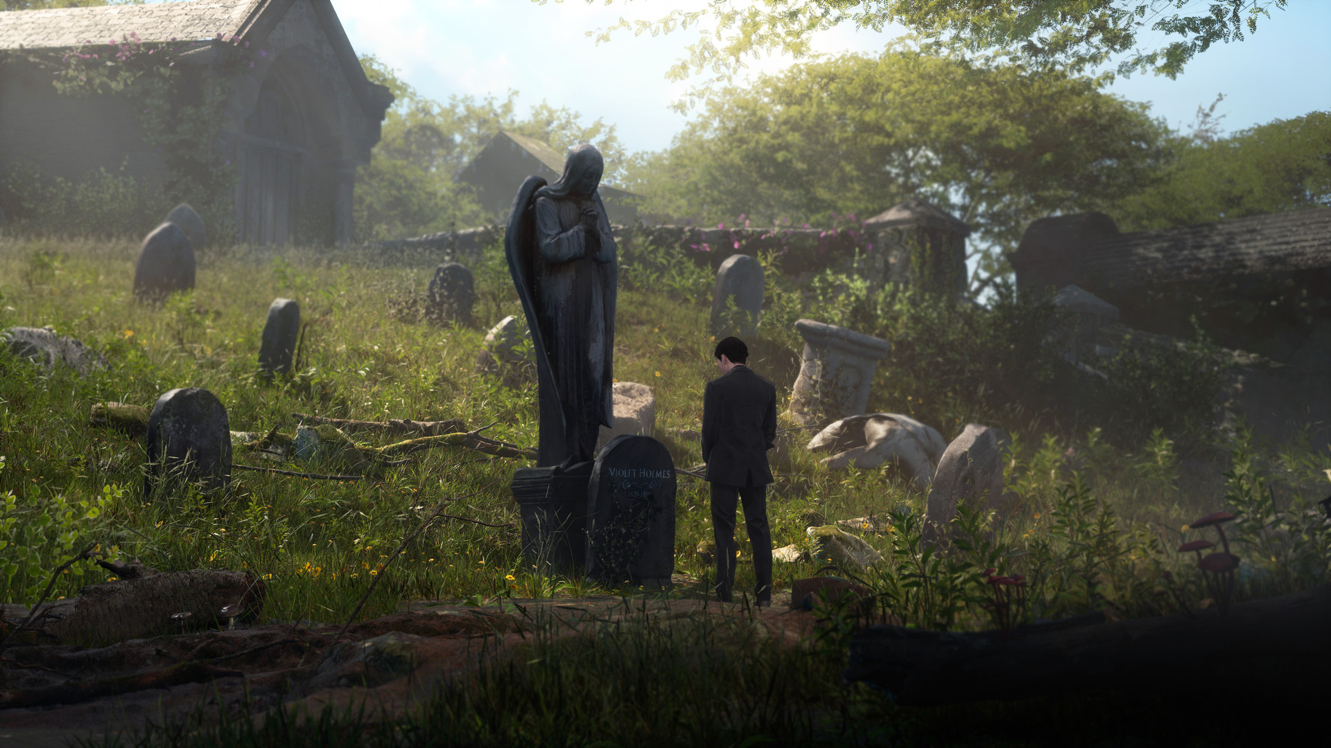 The young Sherlock stands, at middle distance, in front of a large grave topped by a sad-looking angel statue. His head is bowed, and he is obviously feeling sad too.