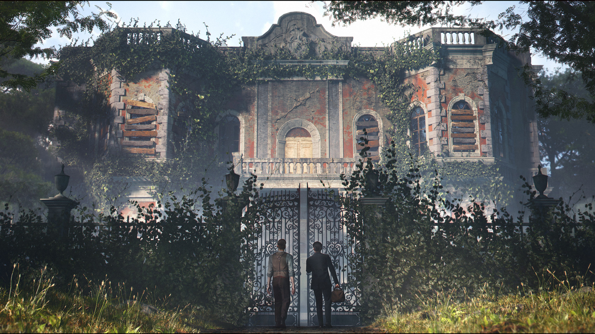 Young Holmes, accompanied by another man of similar age and height, is standing in front of the partially opened iron gates of a stately home. It is mostly going to ruin, with boarded up windows and ivy covering the front of the house