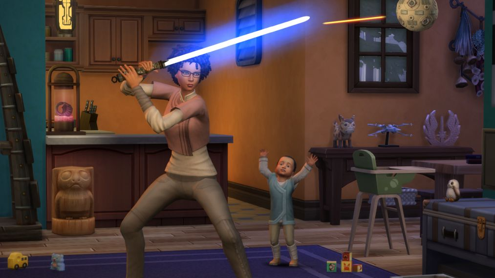 A promo screenshot for Game Pack The Sims 4 Star Wars: Journey To Batuu. A Sim is training with a blue lightsaber, in her home full of Star Wars decorations, while a toddler watches. It seems unsafe.