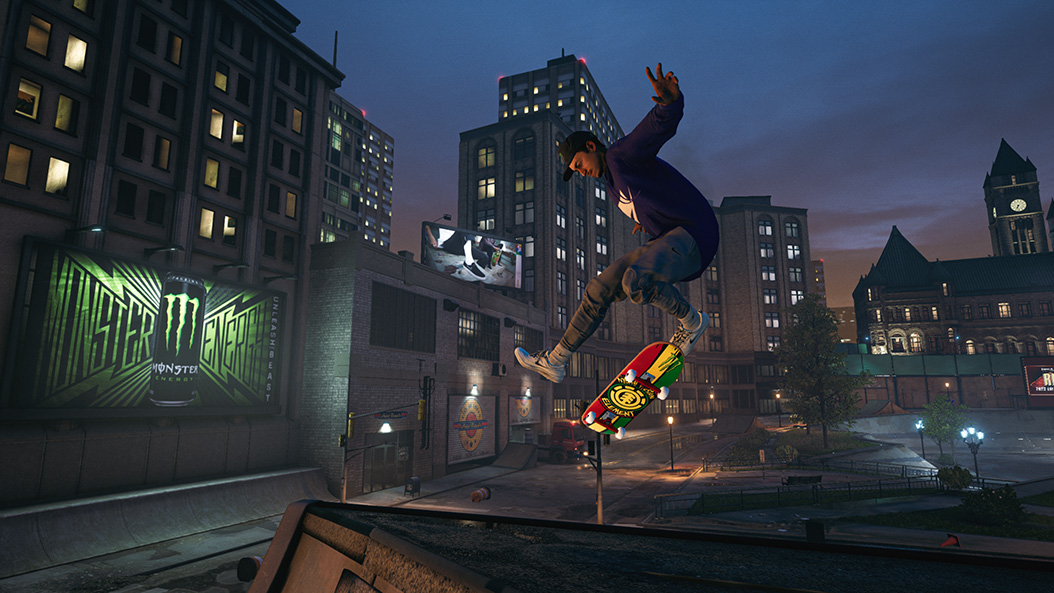 A cool skater does a trick, in mid air, in a night-time cityscape