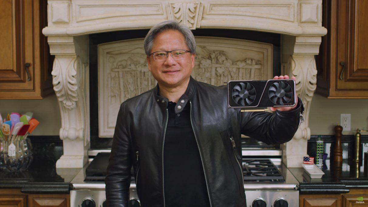A photo of Nvidia's CEO Jensen Huang holding the RTX 3070.