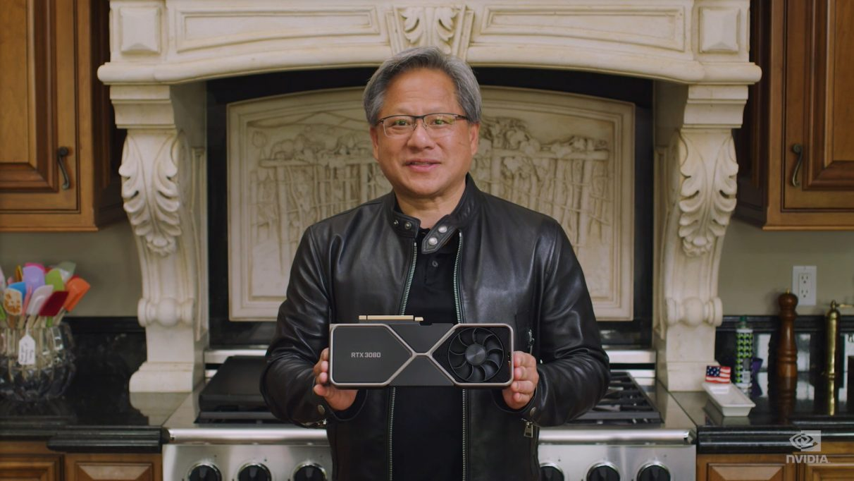 A photo showing Nvidia CEO Jensen Huang holding the new RTX 3080.