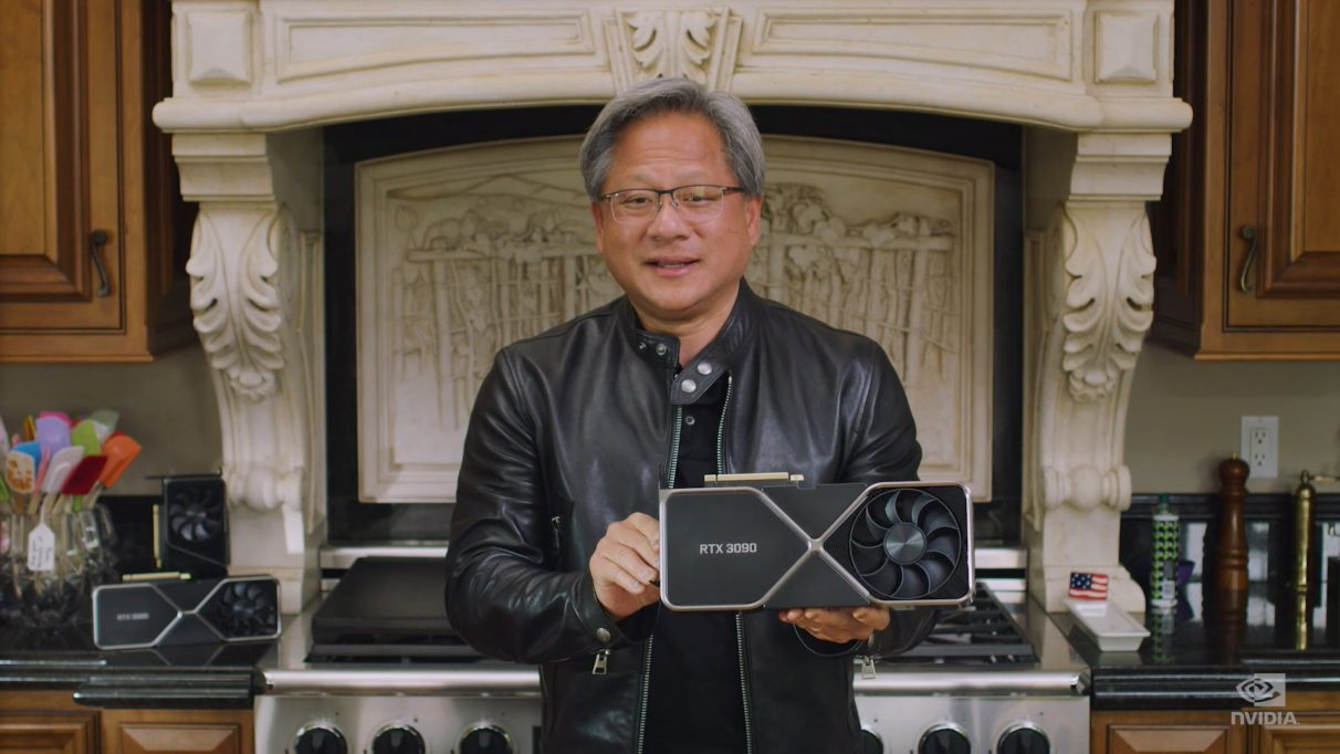 Nvidia's CEO Jensen Huang holding the enormous RTX 3090