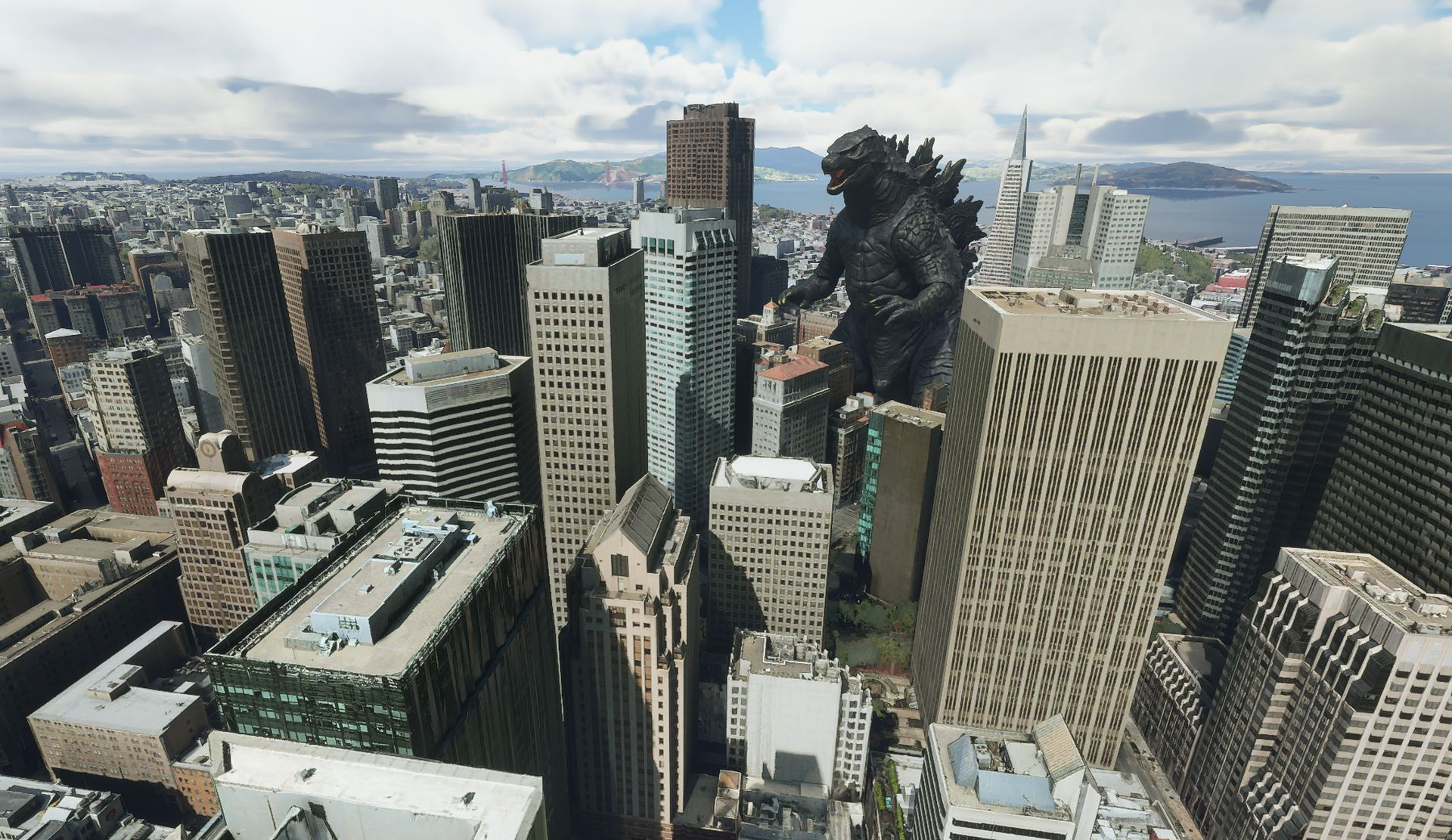 A Microsoft Flight Simulator screenshot. It shows the San Francisco skyline, with a large, sky-scraper sized Godzilla statue in the middle of them.