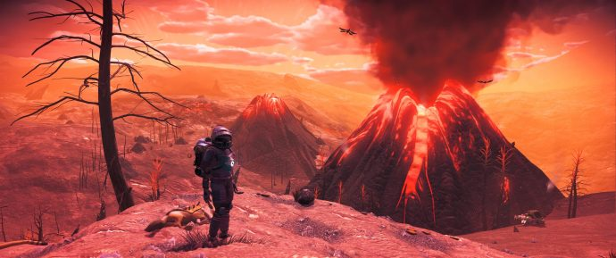 The player poses in front of a volcano in No Man's Sky.