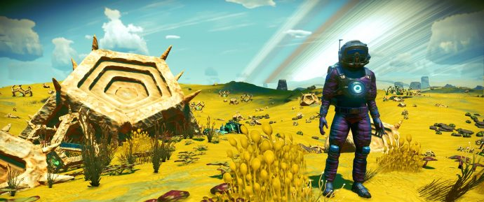 A screenshot of the player beside a strange artifact in No Man's Sky.