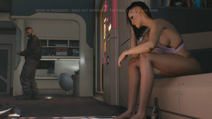 A screenshot from the Cyberpunk 2077 gameplay reveal of 2018. V sits on the side of her bed as the man who stayed the night before leaves without saying a word.