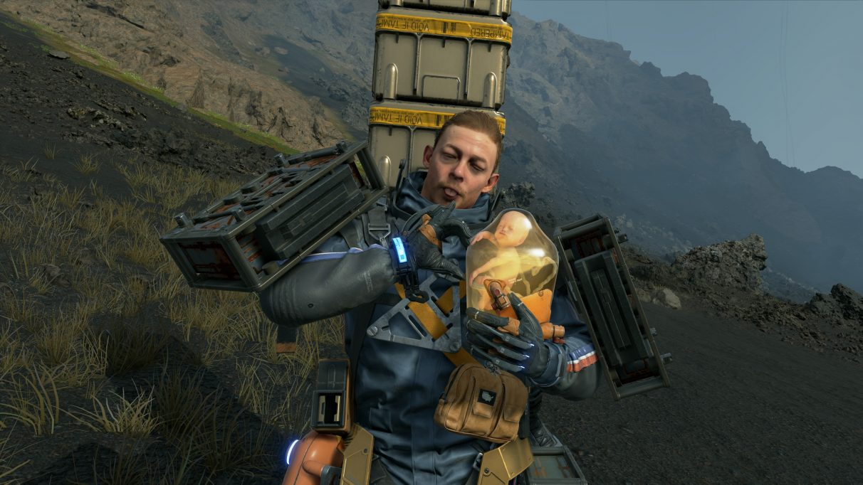 A screenshot of Sam and BB making heart signs in Death Stranding.