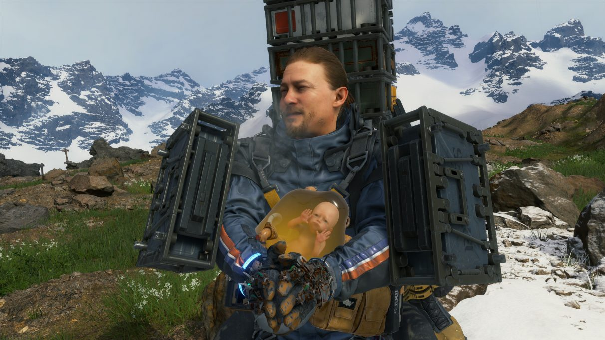 A screenshot of Sam Bridges shivering from the cold in Death Stranding.