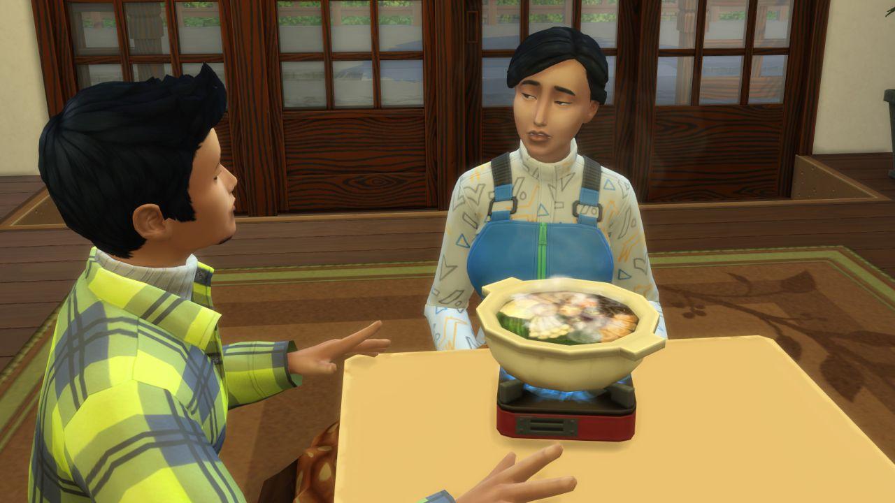 A screenshot of my two Sims, Yasmin and Glen, sitting at a kotatsu table and sharing food from the communal hotpot bowl. Yasmin is pulling a weird awkward face.