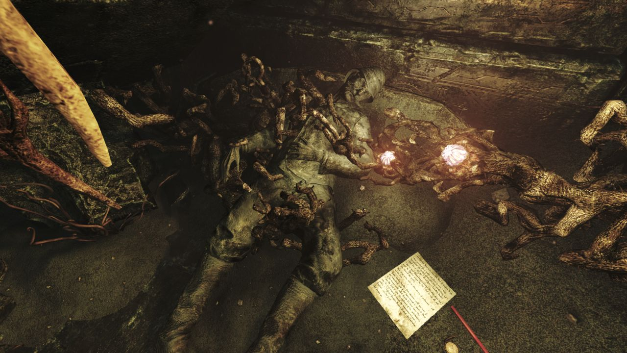 A screenshot from Amnesia: Rebirth showing a man lying on the ground. He is dressed like a stereotypical Victorian explorer, with knee high boots and a pith helmet, but he appears to have been turned to stone.