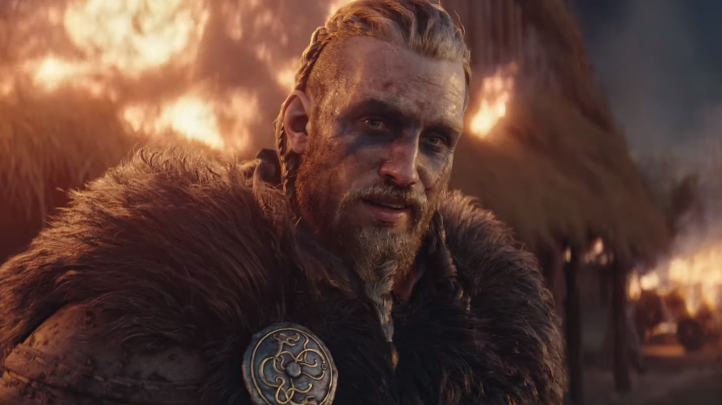 A close up of male Eivor from the cinematic trailer