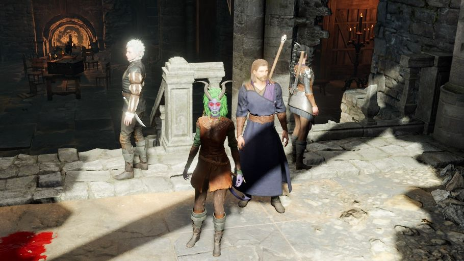 A screenshot of my party in Baldur's Gate 3. Tav Wonderwall, lead singer, is standing facing the camera. The others - Shadowheart the cleric, Astarion the rogue and Gale the wizard - are standing behind them facing different directions. They're in an underground ruin.