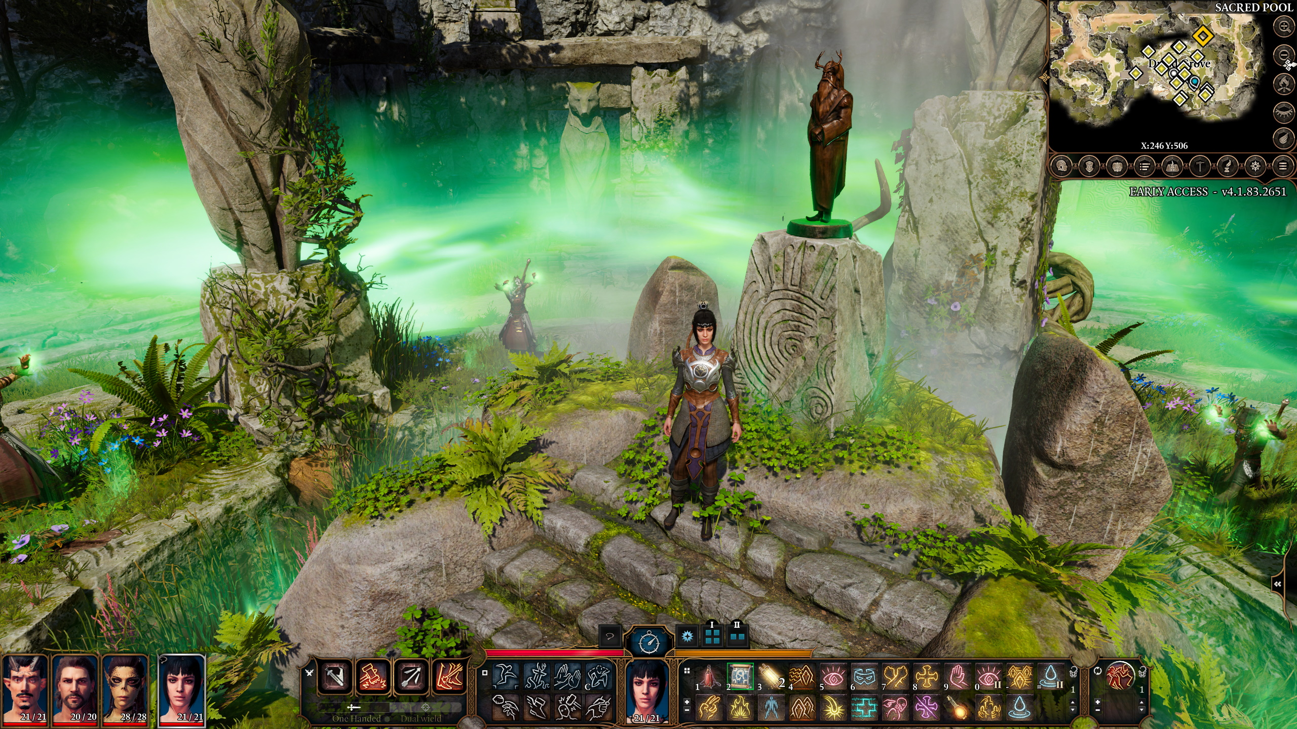 A screenshot from Baldur's Gate 3 showing the team standing around an overgrown stone ruin in a grove. They are surrounded by moss and plants and it is very pretty